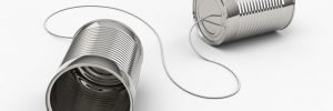two tin cans attached by a string