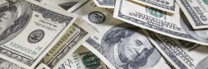 multiple 100 dollar bills scattered